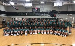 "Kingwood and Kingwood Park volleyball programs wear the same shirt sporting the phrase ""One Team, One Family""."
