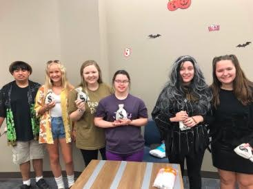 Students hanging out at the Mustang Pals Halloween Social