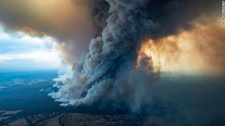 Three fires have combined to form a single blaze bigger than the New York borough of Manhattan, as Australian firefighters battle what has been predicted to be the most catastrophic day yet in an already devastating bushfire season. - By Nectar Gan and Hilary Whiteman, CNN