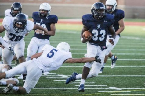 Sewo Olonilua leads Blue past White at Kingwood spring game, 2014.