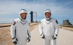 Astronauts Douglas Hurley and Robert Behnken pose at a dress rehearsal for the Demo-2 mission.