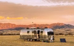 The Longnecker family's Airstream in front of the mountains of Arizona.