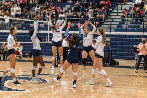 """The girls celebrate a point against Summer Creek. Photo Courtesy of Garrett Smith"""