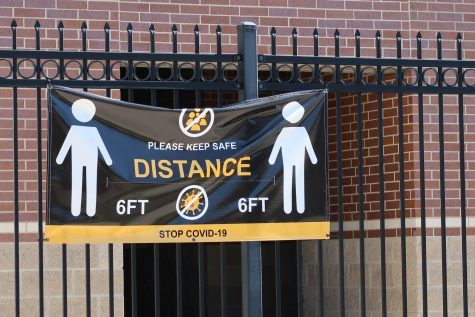 A sign promoting social distancing seen at Turner Stadium.
