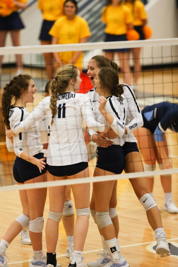 The girls celebrate a block kill by junior Emma Montes. Photo courtesy of Kingwood Volleyball.